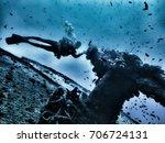 silhouetted scuba diver... | Shutterstock . vector #706724131