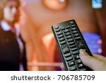 watching tv and using remote...   Shutterstock . vector #706785709