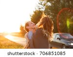 a couple at a country road. he... | Shutterstock . vector #706851085