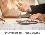 a businessman analyzing... | Shutterstock . vector #706860361