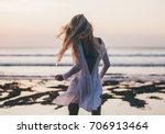 beautiful blonde girl in white... | Shutterstock . vector #706913464