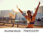 the athletic girl runner raised ... | Shutterstock . vector #706923259