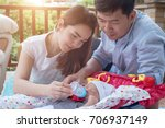 happy family with newborn baby... | Shutterstock . vector #706937149