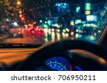 vintage tone blur image of people driving car on night time for background usage. (take photo from inside) - stock photo