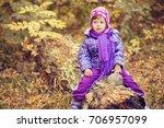 little girl in the autumn... | Shutterstock . vector #706957099