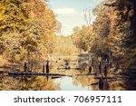 autumn landscape. the lake in... | Shutterstock . vector #706957111