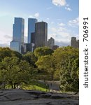 This is a view from the top of some glacial rocks at Central Park in New York. - stock photo