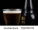 Chilled beer bottle and glass with water droplets on - stock photo