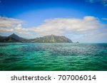 View of the clear turquoise waters of Kaneohe Bay as seen from the iconic sandbar in Oahu, Hawaii with the famous Chinamen