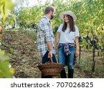 loving couple harvesting red... | Shutterstock . vector #707026825