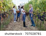young women friends harvesting... | Shutterstock . vector #707028781