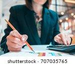 businesswoman analyzing... | Shutterstock . vector #707035765