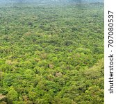 rainforests. view from above.... | Shutterstock . vector #707080537