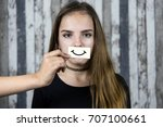 fake smile. mask.  | Shutterstock . vector #707100661