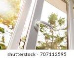 opened white plastic pvc window | Shutterstock . vector #707112595