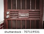 red mail drop on metal door... | Shutterstock . vector #707119531
