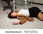 Crime scene with killed businesswoman in a office - stock photo
