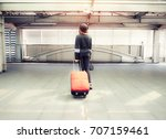 woman pulling suitcase at... | Shutterstock . vector #707159461