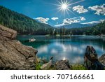mountain lake and dark green... | Shutterstock . vector #707166661