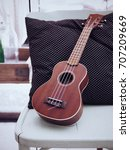 ukulele on white chair and... | Shutterstock . vector #707209669