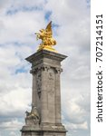 Small photo of The sculpture on the bridge of Alexander III in Paris