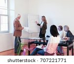 co workers giving presentation... | Shutterstock . vector #707221771