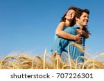 man carrying woman in a wheat... | Shutterstock . vector #707226301