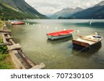 tranquil scene with boats on... | Shutterstock . vector #707230105