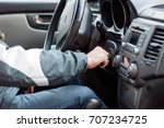 hand with key in ignition. key... | Shutterstock . vector #707234725