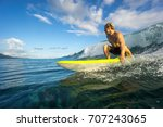 muscular surfer with long white ...   Shutterstock . vector #707243065