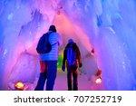 Small photo of In the hall room Illuminated ice cave at Snow Festival Sapporo, Hokkaido, japan.