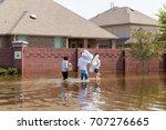 residents in walk in high... | Shutterstock . vector #707276665