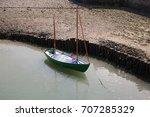 A Small Sail Boat Moored At...