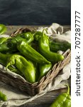 raw green spicy hatch peppers... | Shutterstock . vector #707287777