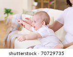 a young mother playing with her ... | Shutterstock . vector #70729735