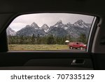 rain over the grand teton... | Shutterstock . vector #707335129