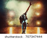young man break dancing in club ... | Shutterstock . vector #707347444