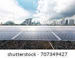 Solar Panel And Cityscape Of...