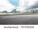 empty asphalt road and... | Shutterstock . vector #707350204