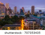 buildings in the city by night | Shutterstock . vector #707353435
