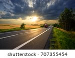 red truck arriving on the... | Shutterstock . vector #707355454
