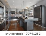 Stock photo ultra modern kitchen with stainless steel island 70741252