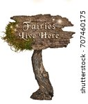Small photo of Weathered Wood sign with Letters Fairies Live Here on isolated background/Aged wooden sign with letters Fairies Live Here