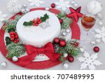 iced christmas cake with red...