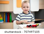 child boy play with wooden... | Shutterstock . vector #707497105