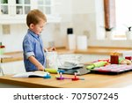 cute child learning to become a ... | Shutterstock . vector #707507245