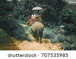 tourists riding elephants... | Shutterstock . vector #707535985