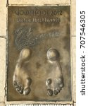 "Small photo of MONACO - JULY 28, 2017: Winner of Golden Foot award (international prize awarded to footballers) leaves a permanent mould of his footprints on ""The Champions Promenade"". 2012 Zlatan Ibrahimovic ."