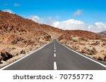 Empty Road Crossing An Arid...