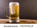 beer in mug on wooden table... | Shutterstock . vector #707579119